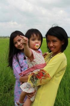 'Kids at padi fields' by shizham